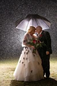 Couple in the mist under an umbrella