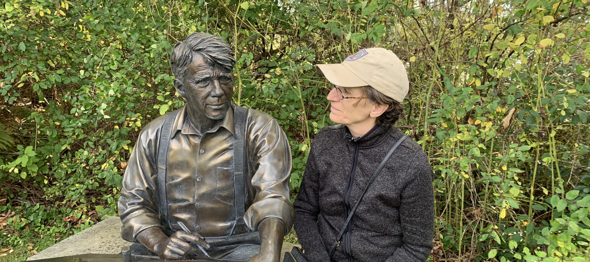 Statue of Robert Frost with MaryAnn sitting next to statute