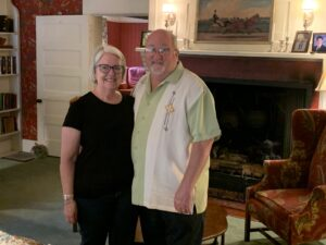 Ellen and Don Clark standing in the Gathering Room at the in.